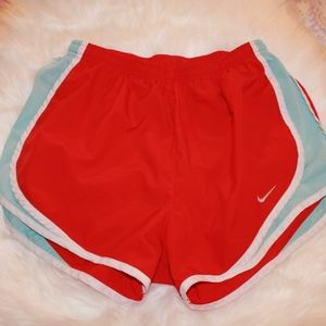 Red and blue women's Nike running shorts